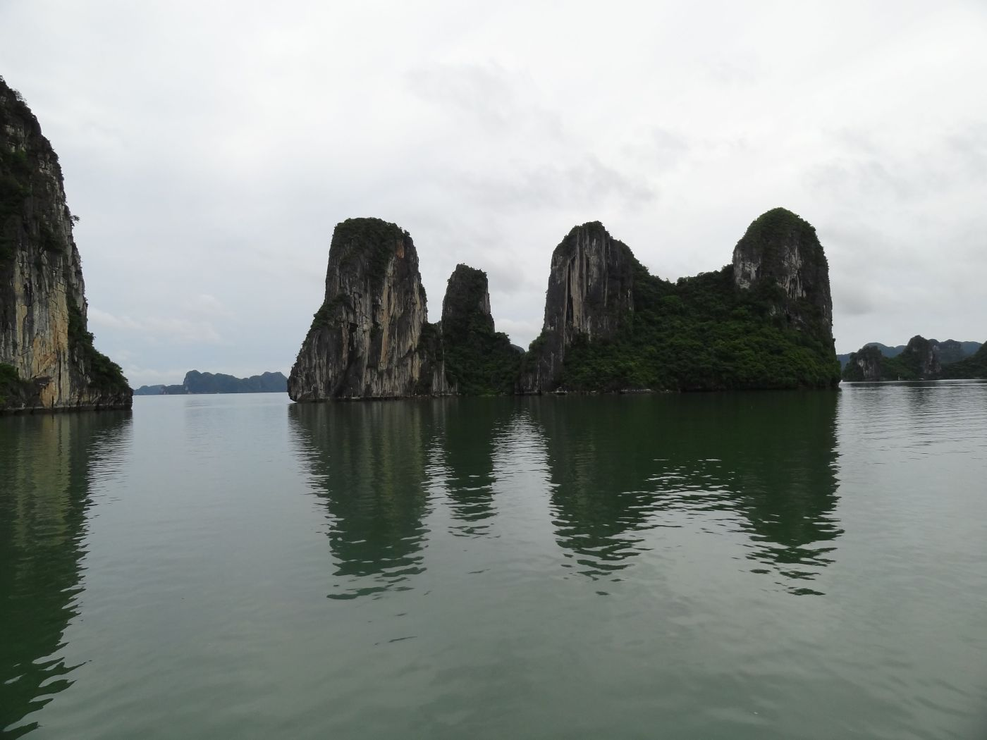 describe ha long bay Vietnam's most obvious attraction is ha long bay, adjacent to the gulf  the name ha long bay is often used to describe the  ha long bay : ha long.